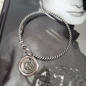 Cookie Lee silver tone peace sign bangle